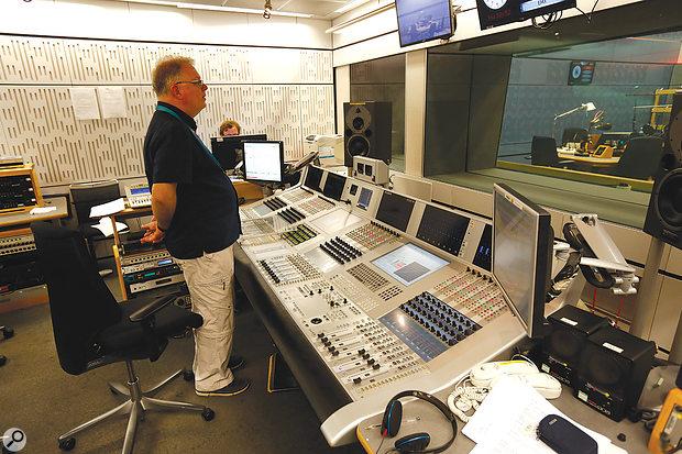 Senior Studio Manager Neil Pemberton listens to a balance during soundcheck for a live performance by Fado singer Ricardo Ribeiro.