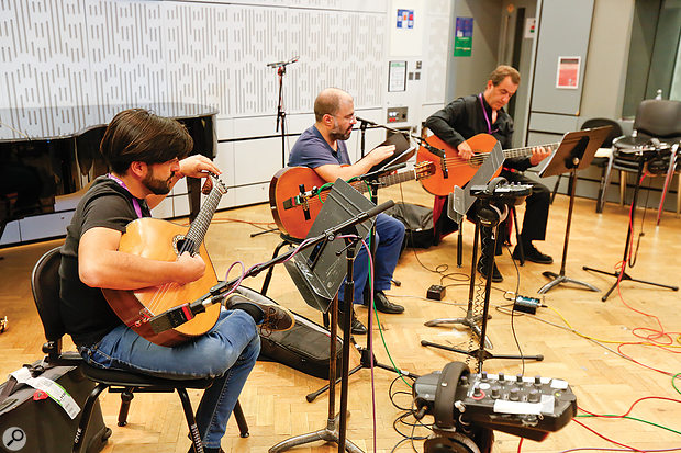 The Fado guitarists in position on the studio floor. The main pair of spaced omnis is just out of shot to the right, while each guitar has an AKG C414 positioned to the player's lower right.