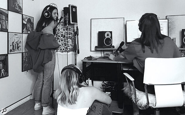 Kenzie Ziegler recording 'Teamwork' at LYRE studios. The track, and its music video, were used to promote Kenzie's clothing brand, Justice.