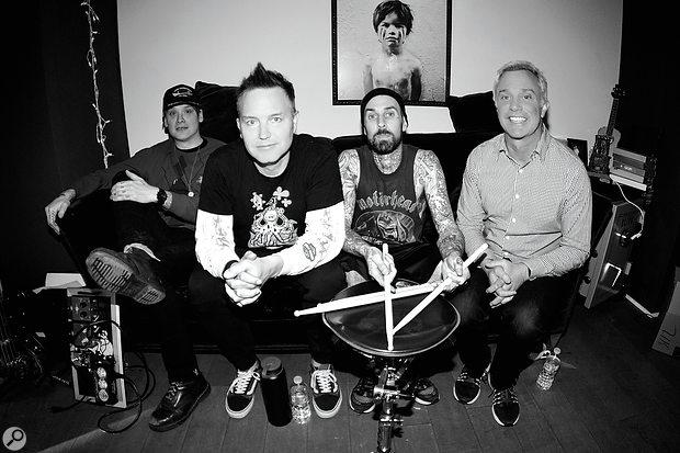 Producer and co-writer John Feldmann (right) poses with the three members of Blink 182 during the making of California. From left: Matt Skiba, Mark Hoppus, Travis Barker.