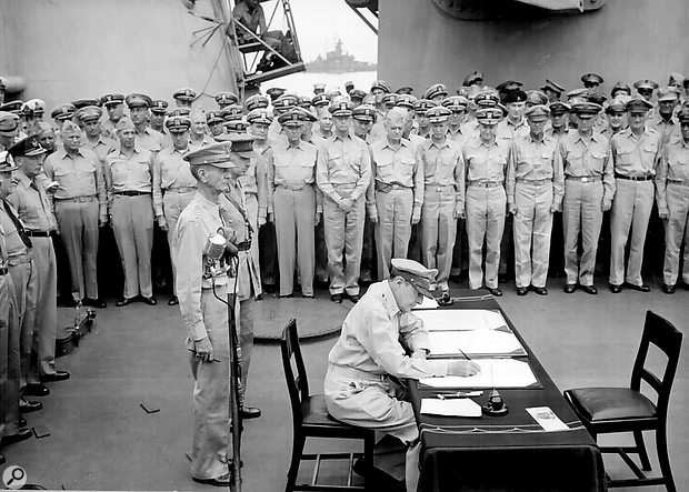 General Douglas MacArthur receives the formal surrender of the Japanese forces on board the USS Missouri, 1945. Note the Shure Model 55 on a  stand behind the desk!