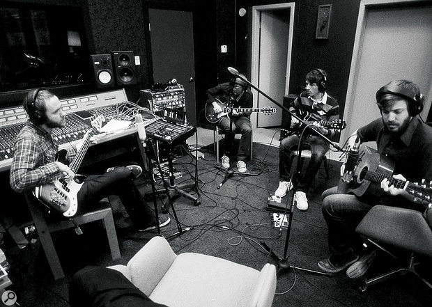 Midlake lay down a take in the control room at their studio. From left: singer Tim Smith, here depping on bass, guitarist Eric Nichelson, guest player Max Townsley and guitarist/singer Eric Pulido.