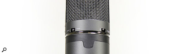The mic body features two switches: one to engage a 10dB pad, and another to engage the high‑pass filter.