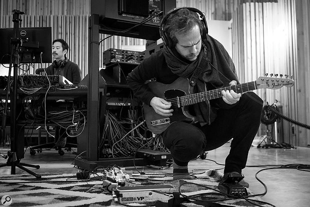Engineer Jonathan Low (left) and guitarist/producer Aaron Dessner (right) at work in Long Pond Studio.