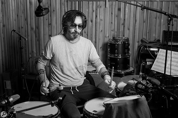 National drummer Bryan Devendorf frequently experiments with different ways of damping the resonance of his drums. Visible in this shot are the spaced pair of Schoeps pencil mics in 'Recorderman' array, and a  Coles 4038.