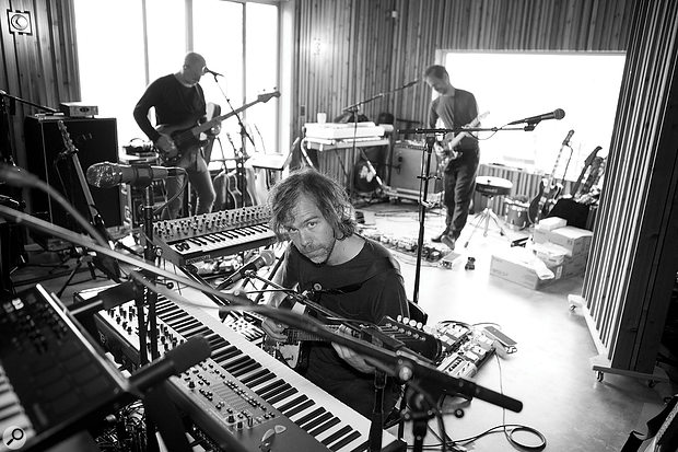 Long Pond is configured as a single large space without a separate control room, enabling the band to lay down live takes as a unit. Aaron Dessner (foreground), twin brother Bryce (rear right) and bassist Scott Devendorf show off the ample natural light in the recording area.