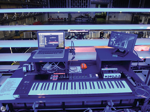 The keyboard rigs were each based around a MacBook running Apple MainStage, a Native Instruments Komplete Kontrol MIDI keyboard and a Komplete Audio 6 interface. The display to the right is a CCTV screen, allowing the players in the 'pods' to see the show's arranger, Joe Duddell, when the slats were shut.