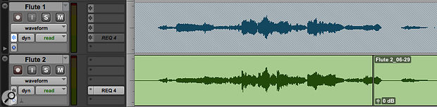 The upper track in this screenshot is frozen: note the greyed-out insert slots and the 'hatched' waveform background.