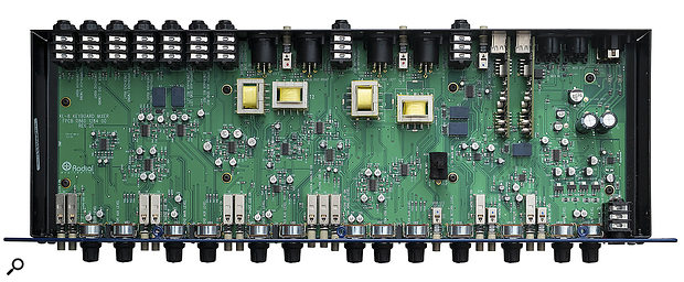 Lifting the lid reveals a large PCB populated with mostly surface-mount devices, with sockets and controls attached directly to the board.