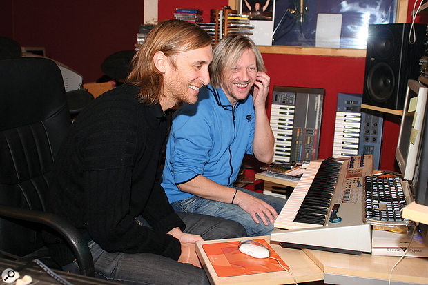 David Guetta (left) and Fred Rister at work during the sessions that produced the Black Eyed Peas' 'I Gotta Feeling' and Guetta's 'When Love Takes Over'. Visible in the background is Rister's Roland Juno 106, which was employed extensively in the early years of the duo's collaboration.