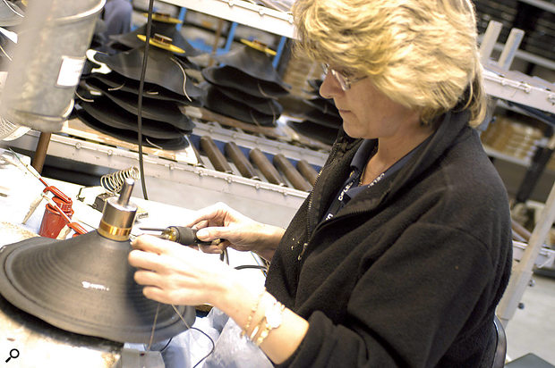 A loudspeaker is born in the Celestion factory. Here, the cone assembly is being constructed.