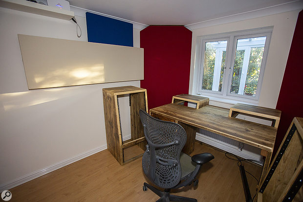 The finished corner bass trap looks smart and does an effective job. This photo also shows the attractive racks and desks made by Chunky Studio Furniture.