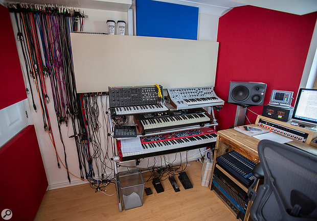 To the left–hand side of the desk are Hugh's keyboards on a Sequenz stand: a Nord Stage Classic (rev C), a Hammond XK-1c, a Korg MS20 (kit), a Moog Sequential CV, and a vintage Yamaha RY20 drum machine.