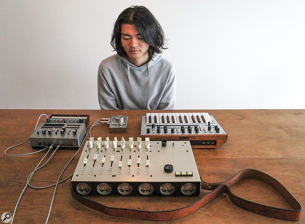 Tatsuya with some of the instruments he has created. In front of him, left to right, are a Korg Volca FM and prototype Monotribe, the Granular Convolver designed for the Red Bull Music Academy, and a Korg Monologue. Nearest the camera is the eight-oscillator synth with battery power and built-in speakers that helped to get Tatsuya his job at Korg.