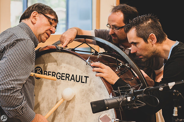 Percussive family (L-R) Leo, Tom and Tim Ouderits take a  fervent interest in a bass drum.