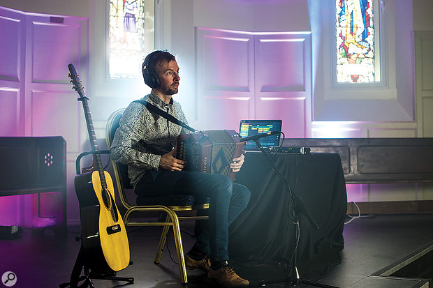Ian Stephenson performs using his melodeon, acoustic guitar, and ALK2 laptop setup.