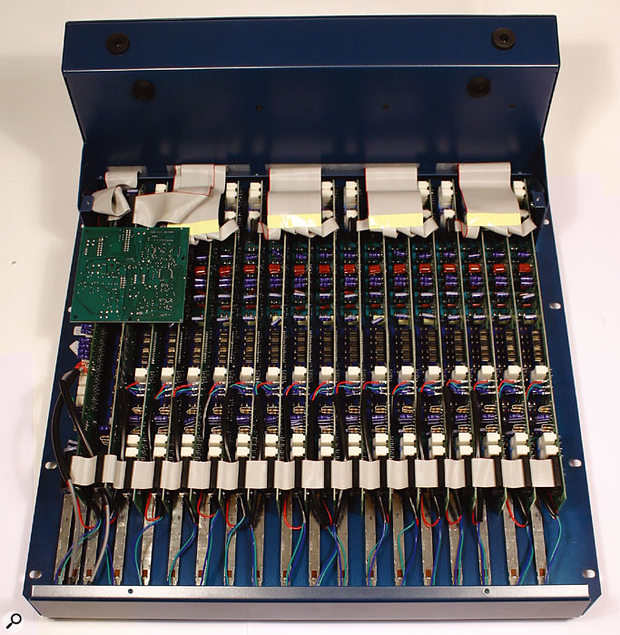 Here you can see the internal construction of the mixer, using individual circuit boards for each channel. The inset on the left shows the IC sockets which can be used to alter the balancing properties of the auxiliary outputs. Jumpers on each channel, shown in more detail in the right-hand inset, can be re-configured to alter the characteristics of the aux sends and direct outputs.