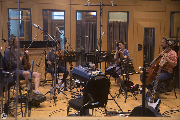 Arranger Sally Herbert (second from left) playing in London's AIR studios at a string-quartet session.