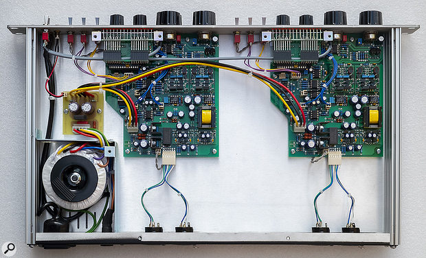 A shot of the internals. Asimple linear power supply in the bottom‑left corner feeds the local regulator circuitry on each channel's circuit board. The yellow-banded 'radio steel' transformers can be seen on the right of each board along with the four modular plug-in discrete Class-A amplifier sub-boards. The compressor side-chain appears to be built using standard ICs.