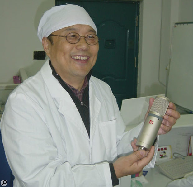 Siwei Zou, head of SE Electronics, proudly displaying one of his Shanghai-based factory's newest mics.