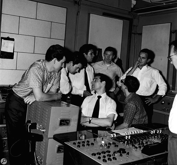 Inside Studio Two, circa 1961: (top row, left to right) guitarist Bruce Welch, drummer Brian Bennett, Cliff Richard, bassist Licorice Locking, Shadows manager Peter Gormley. Cropped, at far right, is producer Norrie Paramor. Malcolm Addey (talking to Brian Bennett) sits at the EMI REDD 17 console, next to guitarist Hank Marvin (with back to camera).