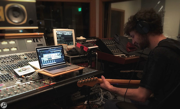 The solution: Michael League records electric guitar through the Universal Audio Apollo Twin, functioning as a real-time effects unit.
