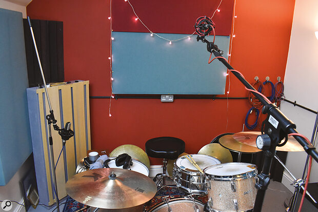 The Glyn Johns technique, with two cardioid mics, one pointing down at the snare, the other 'firing' across the floor tom towards the snare.