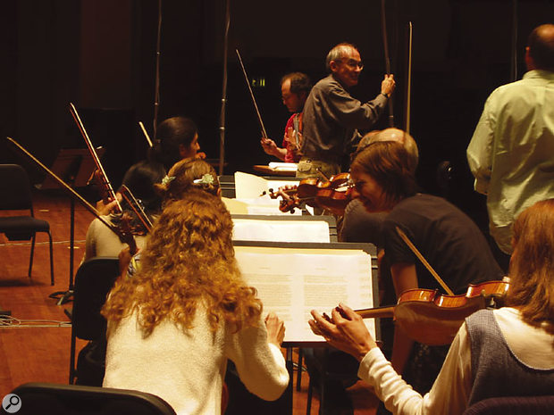 Placing the stage mics at the Symphonic Orchestra sessions. Professor Keith O Johnson (centre, grey shirt and glasses) can be seen fine-tuning the mic positions.