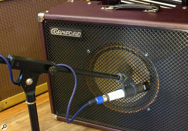 At the edge of the speaker, turning a directional mic off axis will darken/soften the tone even more.
