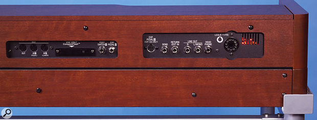 The rear panel of the XK3 (shown here still attached to the XKL3 dual-manual expander underneath) features the MIDI I/O sockets, the Compact Flash slot for data and patch storage, and the connections for a standard footswitch, an expression pedal, and the traditional Hammond EXP100 pedal. In addition to the standard stereo line out and headphone jacks, there are also send and return connections for use with outboard effects, as well as the traditional 11-pin Leslie connector. The XK3's internal valve can be seen glowing away through the grille on the right.