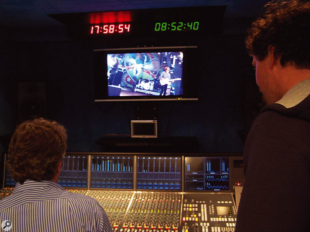 Inside the truck, Floating Earth's Will Shapland (left) sits at the SSL C200 console surveying the festival happenings via a video monitor. This is where the recording of the festival took place.