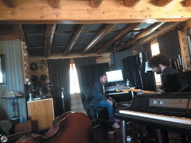 Jesse E String and bassist Joe Ayoub at work in Patrick Leonard's log-cabin studio in the mountains north of LA.