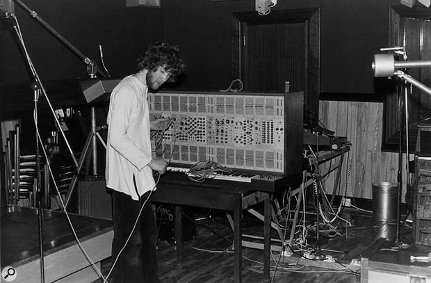 Assistant Ken Thomas sets up an ARP 2500 synth.