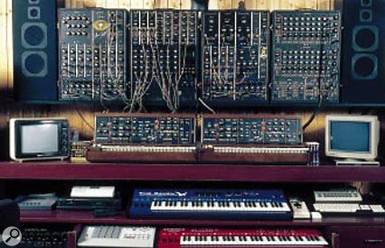 This shot of Klaus Schulze's studio illustrates both his affection for old Moog analogue synthesizers (his Moog C3 modular and two Minimoogs) and his willingness to embrace new digital gear such as the Quasimidi Raven (blue keyboard) and Cyber 6 (red keyboard), shown.