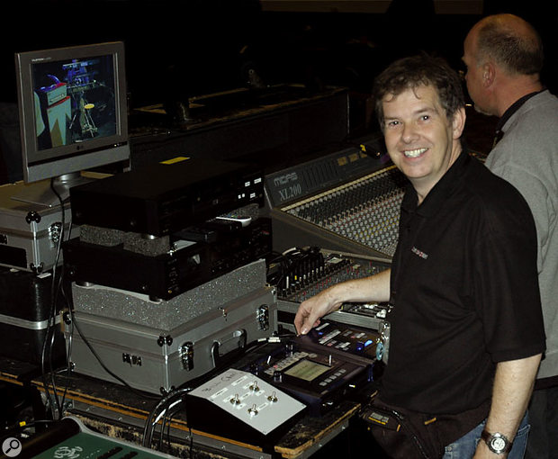 The author on the Bill Nelson tour with his live video mixing rig. The LCD monitor at the top was for checking the four inputs to the Krossfour video mixer without affecting the main output to the on-stage screen. Below that is the DVD player used for the pre-recorded video material during the show, and at the bottom are the white control unit for the two cameras used on stage, plus the Entrancer and Krossfour (right). The Korg units both had to have home-made 'labelling' added due to the lack of built-in scribble strips.