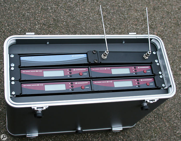 A metal 19-inch rack case safely housing a set of radio-mic receivers.