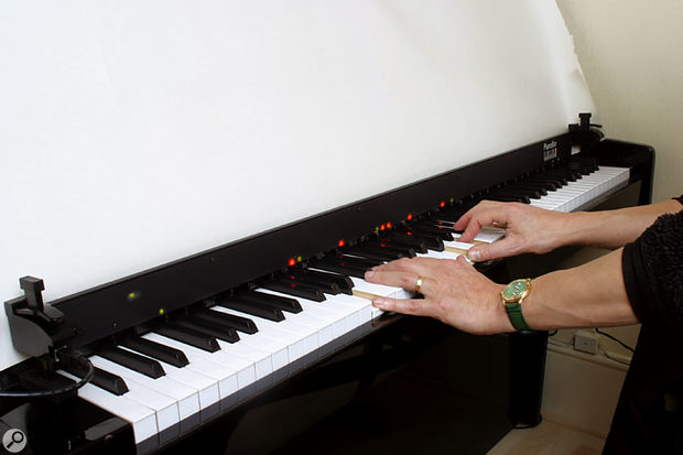The Piano Bar in action. LEDs above each key light to indicate that the note has been triggered by your playing.