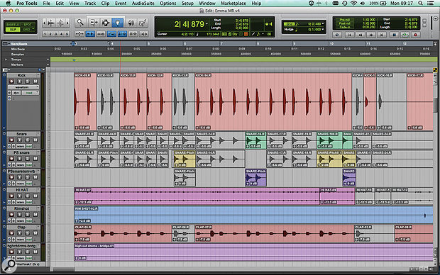 My first step in trying to add variety to the original drum parts was to use the editing tools in Pro Tools to chop up and selectively mute the audio tracks. Note the two duplicate snare tracks (yellow and mauve): these are pitch-shifted down and fed through a non-linear reverb.