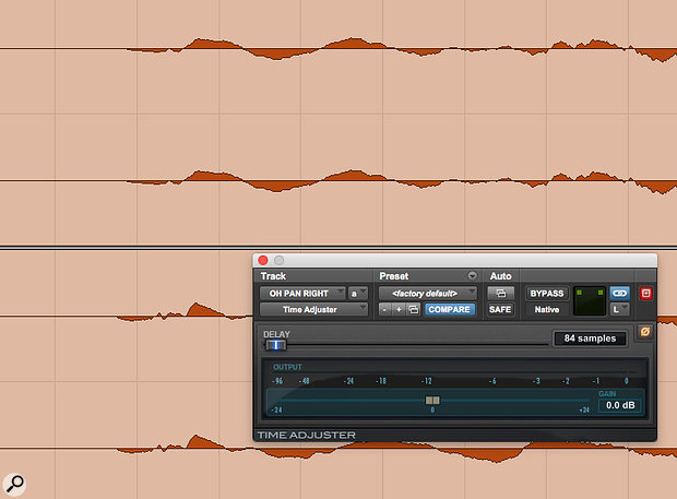 Pro Tools' bundled Time Adjuster plug-in was used to correct the snare's phase relationship with the drum overheads.