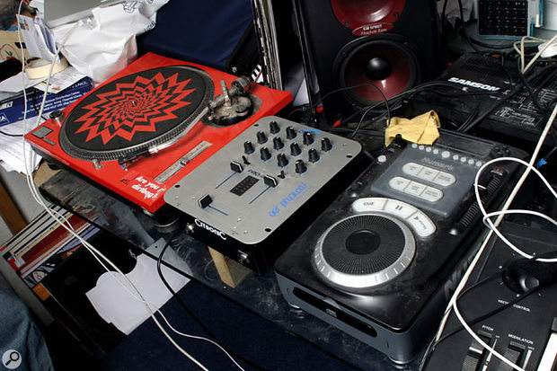 DJ gear includes a record deck and a CD 'turntable'.