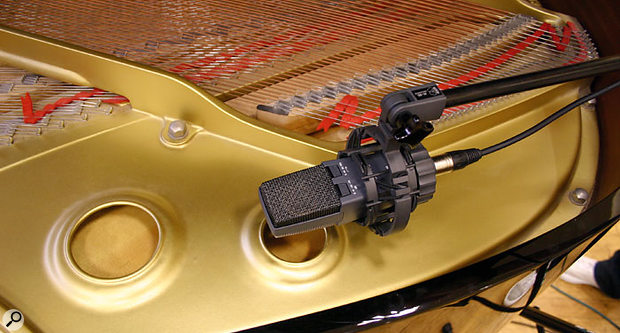 Q. How can I reduce drum spill from piano mics?