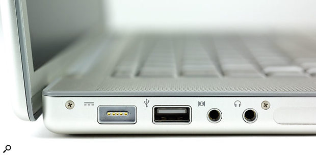 Apple's new Macbook Pro features the 34mm Express Card slot, as shown here (covered by a flap), to the right of the two mini-jack sockets.