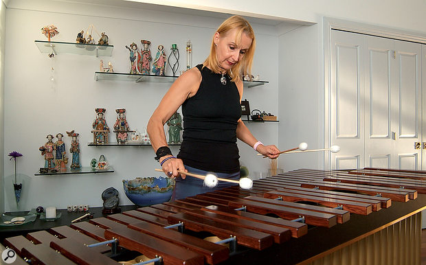 As sound comes from such a large area, it is often a good idea to use a couple of different miking techniques to record a marimba. Placing mics at either end, but still fairly far from the instrument, and below the level of the bars will pick up the resonators (the metal tubes), but will not be too harsh. Alternatively, placing a stereo pair above the head of the player will capture the sound from his or her perspective, though the results could lack resonance.