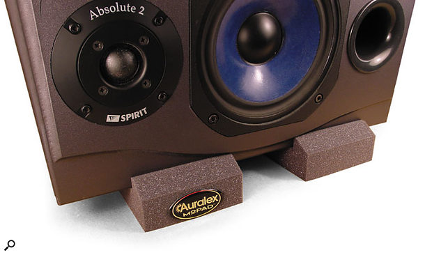 Auralex Mopads can be used to isolate monitors placed on a desktop, but heavy-duty floor stands are best of all.