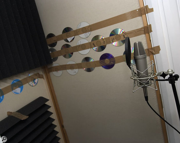 When building a vocal booth, foam can be used to tame high-frequency reflections, while reintroducing some reflective surfaces (in this case old CDs) can counteract an excessively dry sound.