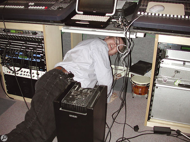 Hugh Robjohns searches for a suitable position for SOS reader Dave Wraight's Genelec 1091 subwoofer during a recent Studio SOS visit.