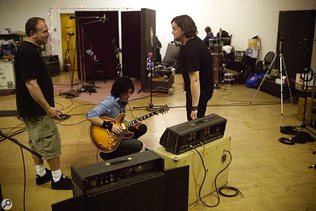 Joe Barresi, guitarist Troy Van Leeuwen and Alain Johannes in Sound City Studio A during the recording of Lullabies To Paralyze.