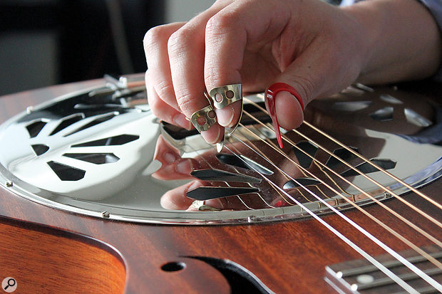 The squared-necked resonator is usually played with finger and thumb picks; the type of pick will have a significant bearing on the guitar's tone.
