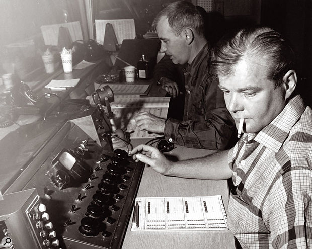 Bill Putnam at one of the mixing consoles he designed.