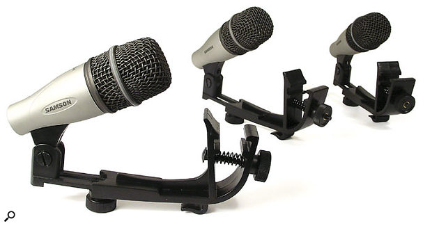 The three tom mics provided in the Q7 set, complete with mounting clamps.